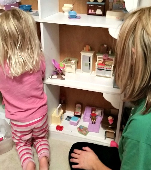 Playing-with-dollhouse