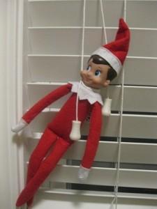 Elf-on-the-Shelf-Ideas-Tied-up-in-Window-Cords-225x300
