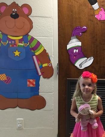 "Anna standing by a bear ""Anna Jo's first day of Preschool!"