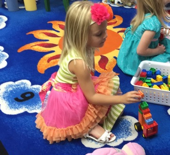 Anna playing with toys at preschool